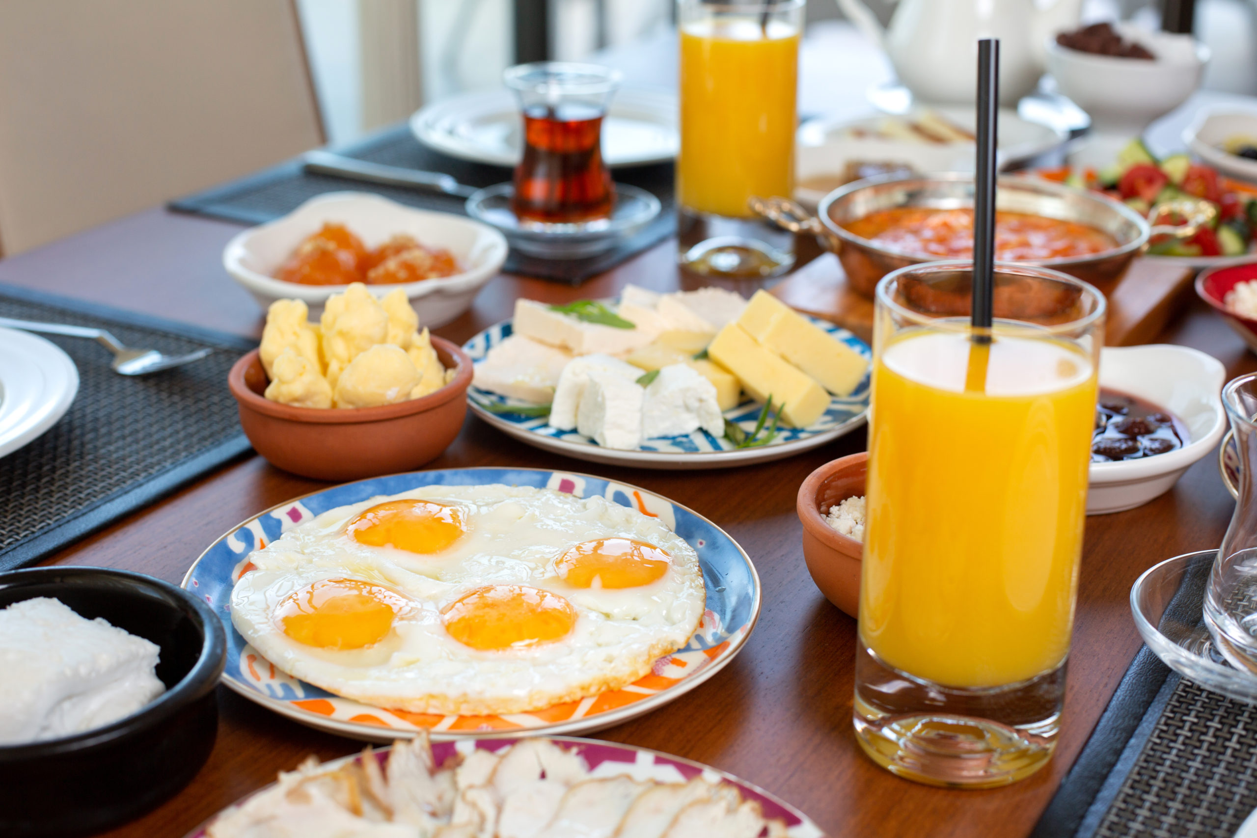 front-view-breakfast-table-with-eggs-buns-cheese-fresh-juice-restaurant-during-daytime-food-meal-breakfast (1)