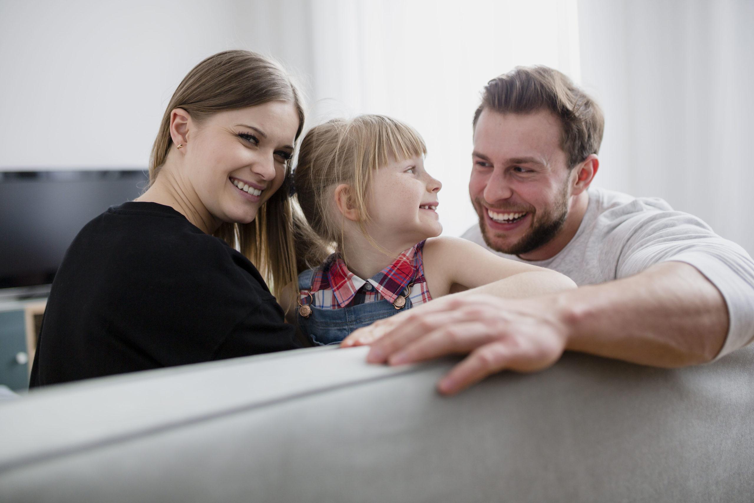 happy-family-on-sofa